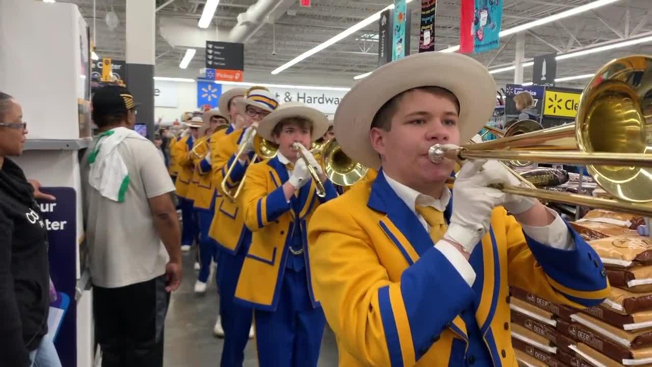 Watch St. Paul's band parade through Covington Walmart