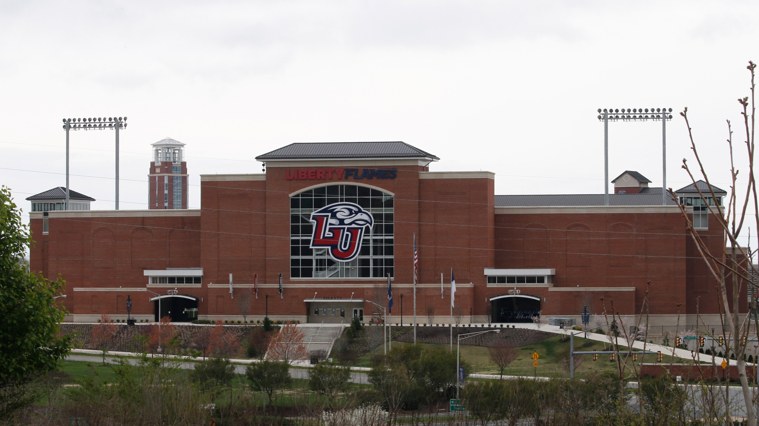 Liberty University's football stadium was empty as students were welcomed back to the university's campus, Tuesday March 24 , 2020, in Lynchburg, Va. Officials in Lynchburg, said Tuesday they were fielding complaints and concerns about the hundreds of students that have returned from their spring break to Liberty University, where President Jerry Falwell Jr. has welcomed them back amid the coronavirus pandemic. (AP Photo/Steve Helber)