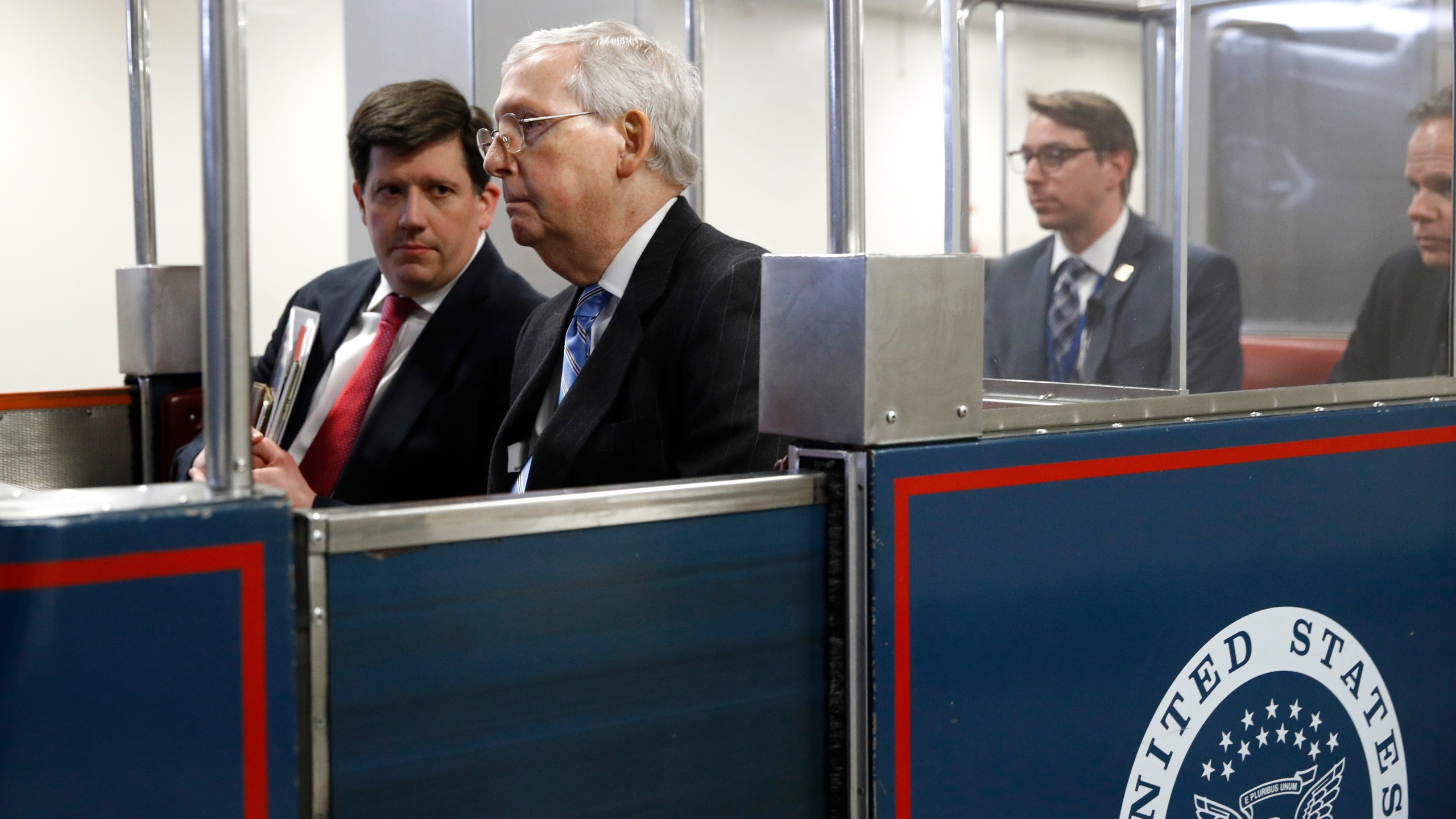 Senate Majority Leader Mitch McConnell rides a subway car on Capitol Hill in Washington before a vote on a coronavirus response bill. (AP file/Patrick Semansky)