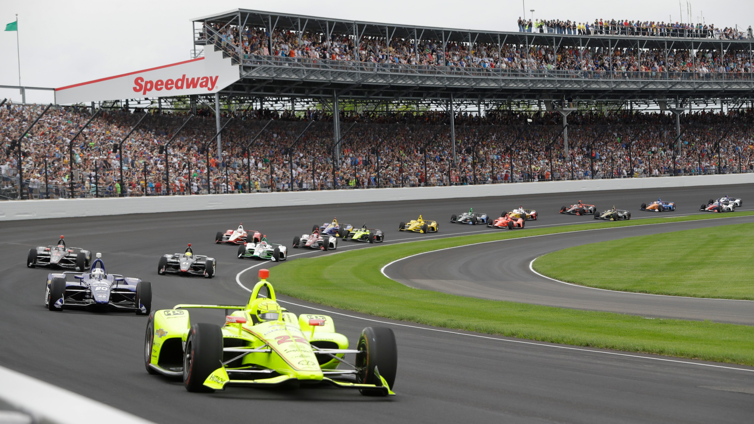 Simon Pagenaud, of France, leads the field through the first turn on the start of the Indianapolis 500 in 2019 The Indianapolis 500 scheduled for May 24 has been postponed until August because of the coronavirus pandemic and won't run on Memorial Day weekend for the first time since 1946. The race will instead be held Aug. 23. (AP Photo/Darron Cummings, File)
