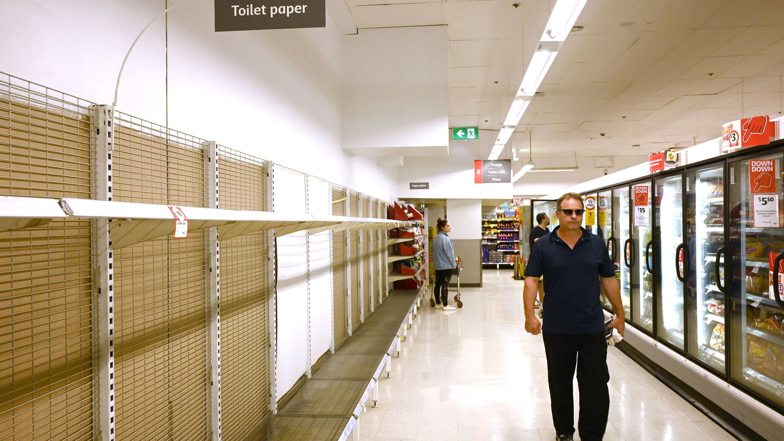 Shelves are empty of toilet paper in a supermarket in Sydney, Australia. (Photo by PETER PARKS/AFP via Getty Images)