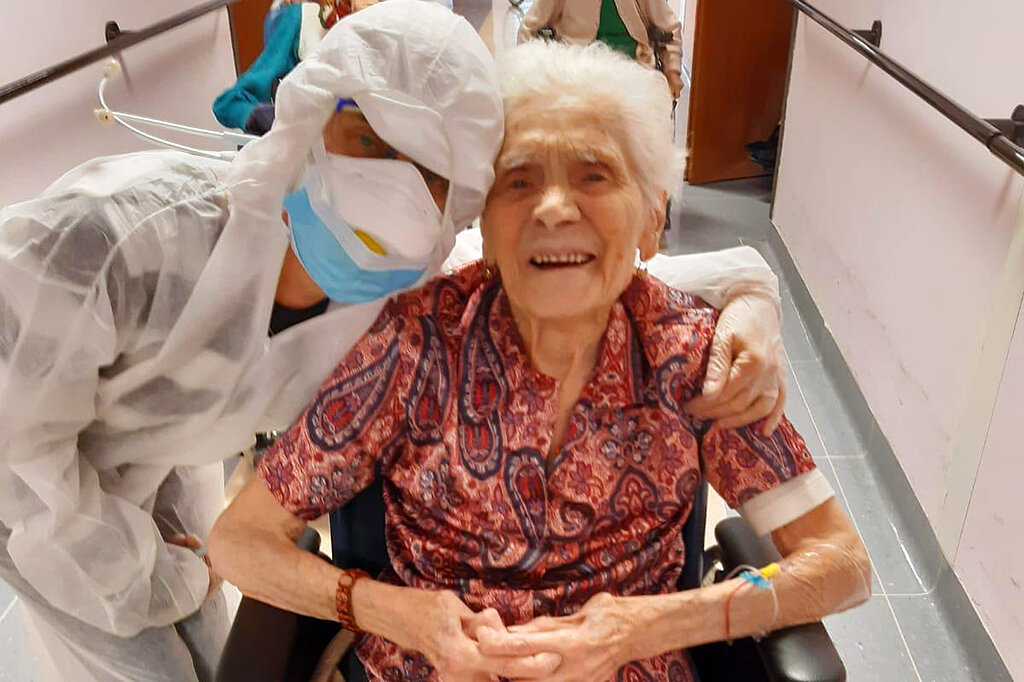 "103-year-old Ada Zanusso poses with a nurse at the old people's home ""Maria Grazia"" in Lessona, northern Italy after recovering from Covid-19. To recover from coronavirus infection, as she did, Zanusso recommends courage and faith, the same qualities that have served her well in her nearly 104 years on Earth. (Residenza Maria Grazia Lessona via AP Photo)"