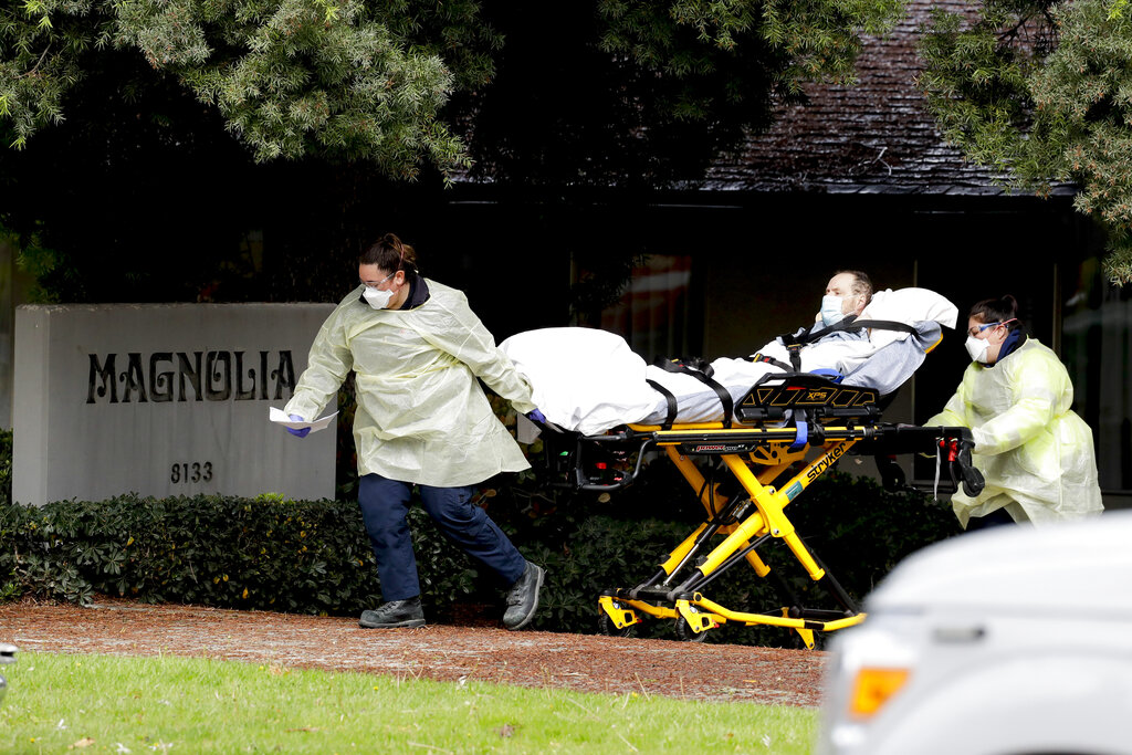 A patient is evacuated from the Magnolia Rehabilitation and Nursing Center in Riverside, California. (AP Photo/Chris Carlson)