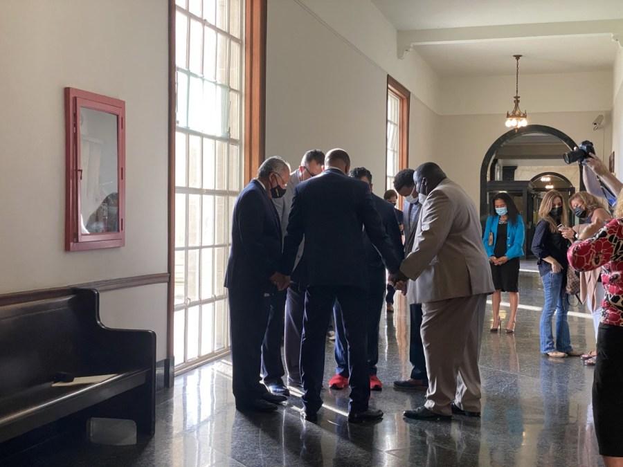 Prayer circle at NOLA October election qualifying