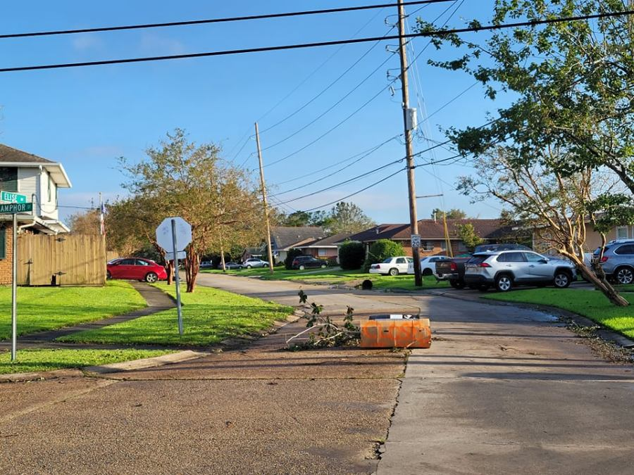 Neighbors block off street in Metairie; downed trees preventing access