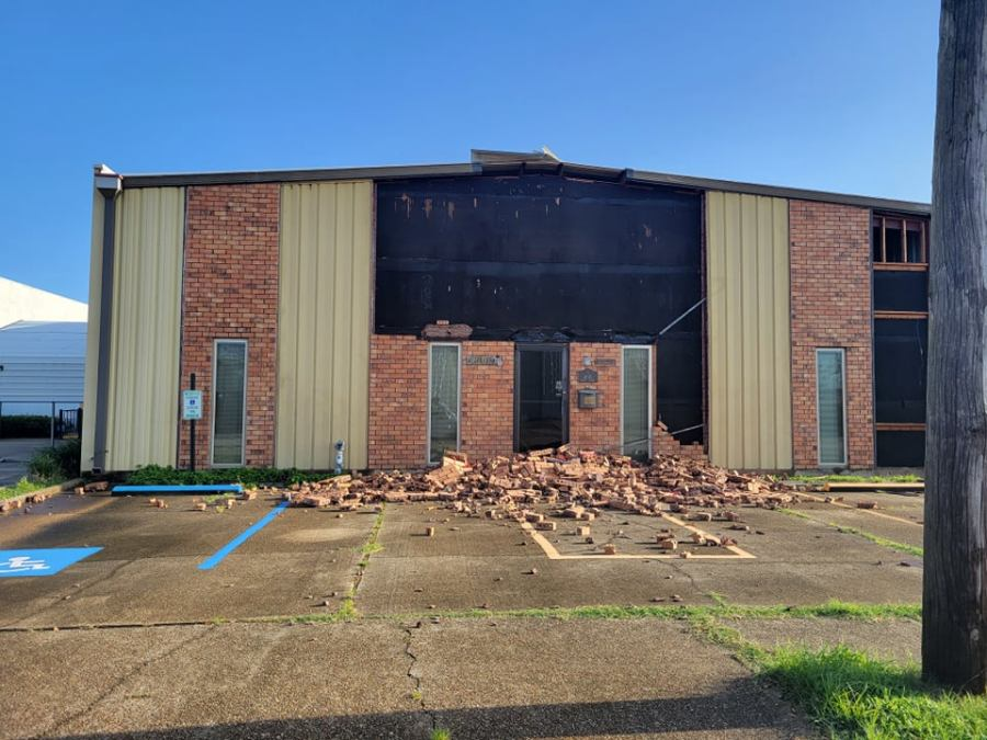 Bricks ripped off of Metairie business