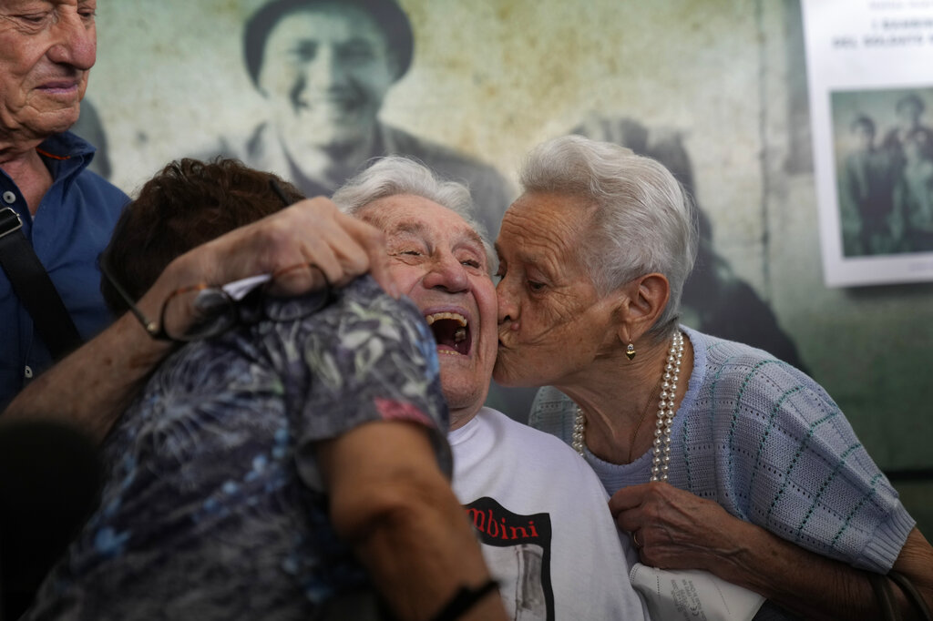 Photos: 97-year-old WWII veteran reunites with Italians he saved as children